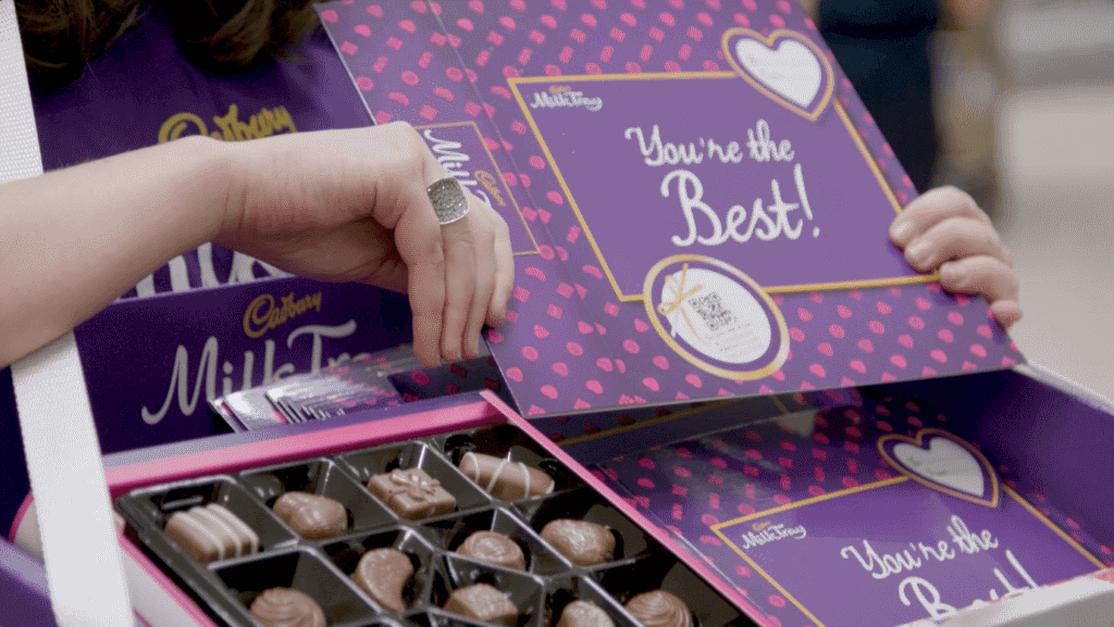 Boxes of personalised Cadbury chocolate with a QR code.